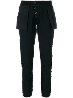 вывернутые наизнанку зауженные брюки Unravel Project