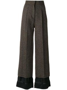 расклешенные брюки Maison Margiela