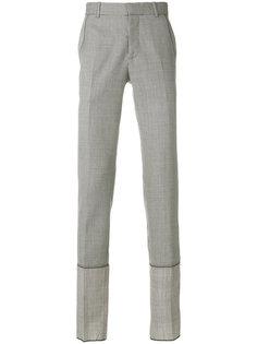 клетчатые брюки Alexander McQueen