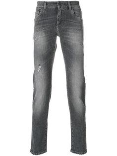 джинсы с протертыми деталями Dolce & Gabbana