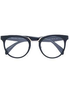 очки в круглой оправе Prada Eyewear