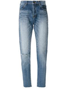 состаренные зауженные джинсы  Saint Laurent