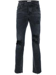 джинсы с выцветшим эффектом и эффектом рванины Pierre Balmain