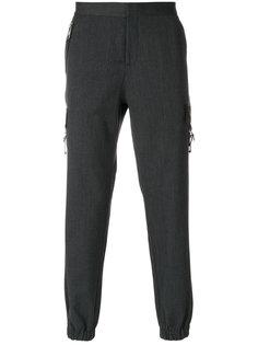 брюки с присборенными манжетами Versus
