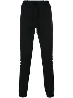спортивные штаны с вышивкой Unravel Project