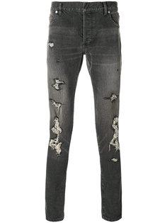 джинсы кроя слим с потертой отделкой Balmain