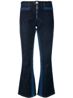 расклешенные джинсы Courrèges
