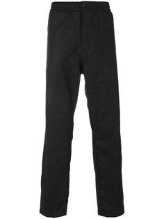 эластичные брюки Universal Works