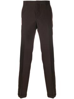 брюки с узором в ломаную клетку Prada