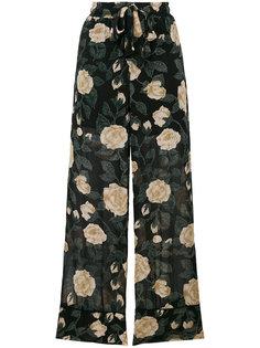 брюки-палаццо с цветочным узором Ganni