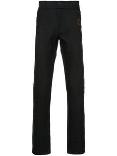 брюки скинни с заплатками Yang Li