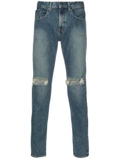 джинсы с рваными деталями monkey time