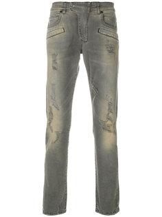 джинсы с потертой отделкой Pierre Balmain