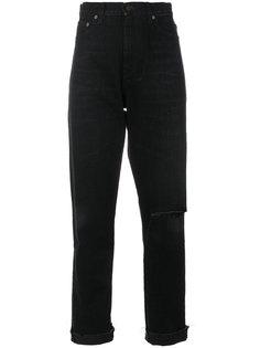 джинсы с прорехами на коленях  Saint Laurent