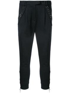 зауженные брюки с заклепками  Thomas Wylde