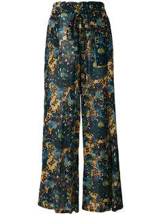 расклешенные брюки с цветочным принтом Raquel Allegra