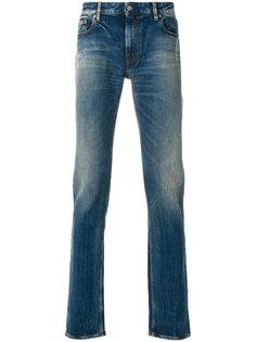 джинсы с потертой отделкой Stone Island