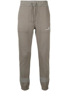 спортивные брюки с лямками на манжетах Undercover