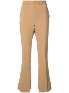 классические расклешенные брюки Toga