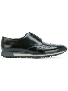кроссовки с перфорацией Prada