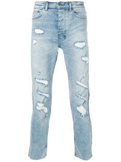 джинсы с потертым эффектом Ksubi