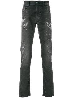 джинсы с прорванными деталями Diesel