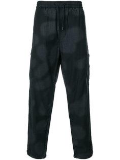 спортивные брюки с линялыми эффектом Maharishi