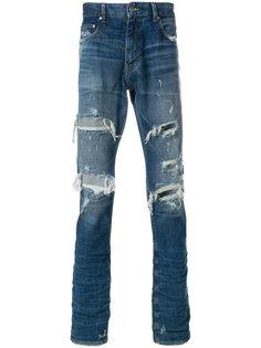 джинсы с рваными деталями Super Légère