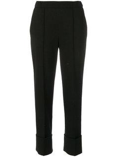 брюки с подворотами Nanushka