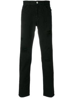 джинсы с потертой отделкой Versus
