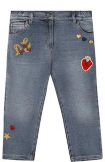 Джинсы с декоративными потертостями и аппликациями Dolce & Gabbana