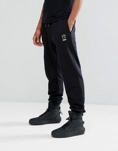 Черные джоггеры Puma x XO 57535001 - Черный