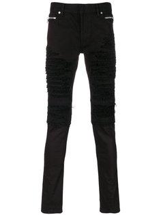 рваные джинсы в байкерском стиле Balmain