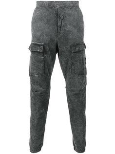 хлопковые спортивные брюки с эффектом белого налета Stone Island