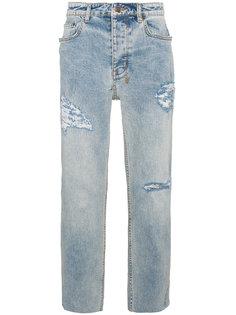 джинсы с протертыми деталями Givenchy