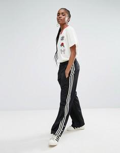 Брюки с широкими штанинами и кнопками у нижнего края adidas Originals - Черный