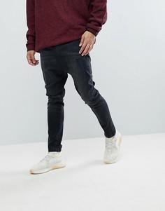 Выбеленные черные рваные джинсы заниженного кроя ASOS - Черный