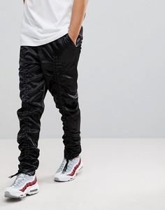 Нейлоновые брюки заниженного кроя со шнурками ASOS - Черный