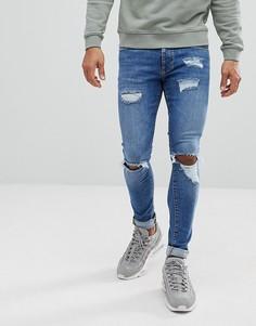 Выбеленные супероблегающие джинсы с рваной отделкой River Island - Синий