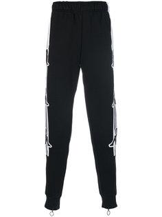спортивные брюки с полосками по бокам Kappa