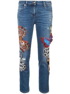 джинсы скинни с бабочками Roberto Cavalli