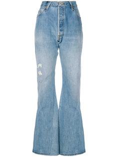 расклешенные джинсы с рваными деталями Re/Done