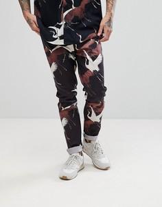 Черные комбинируемые брюки скинни с принтом птиц ASOS - Черный