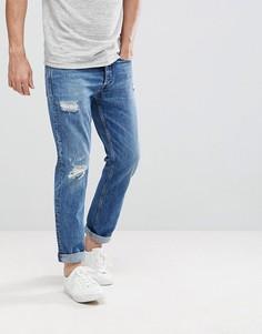 Суженные книзу джинсы с рваной отделкой Calvin Klein - Синий
