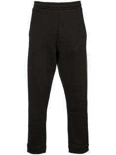 спортивные брюки с красной полоской 032C