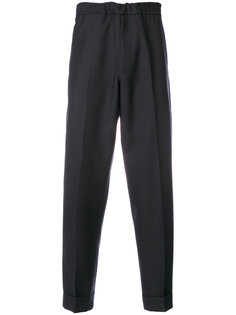 зауженные брюки с отворотами Pt01