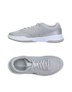 Низкие кеды и кроссовки Lacoste Sport