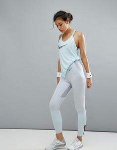 Серые леггинсы с классической талией Nike Training - Серый
