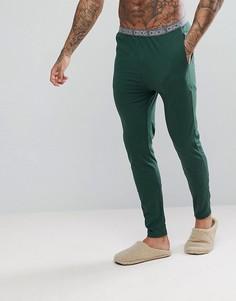 Трикотажные пижамные брюки узкого кроя с фирменным поясом ASOS - Зеленый