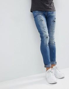 Светлые супероблегающие джинсы с эффектом потертости Blend - Синий